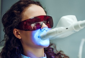 woman in dental chair having whitening treatment