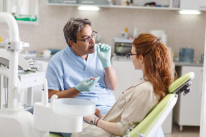 Dentist talking to patient about dental care